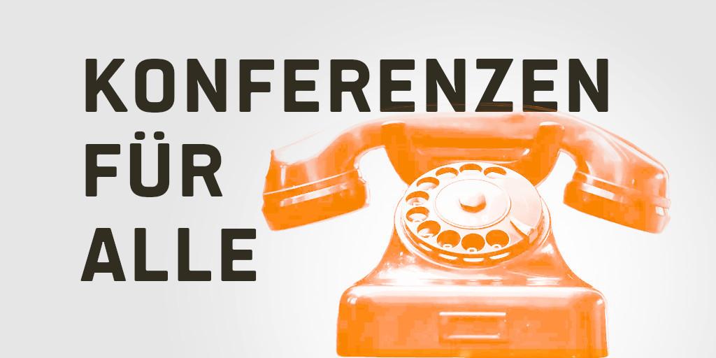 """Auf dem Bild ist ein altes Telefon mit dem Schriftzug """"Konferenzen für alle"""" zu sehen."""